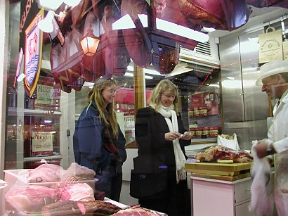 Sisters in a butcher shop in Oxford buying Vegetarian haggis