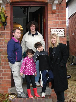 Family standing on stoop in Birmingham, England