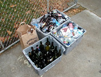 bottles and cans in recyling boxes after the halloween party