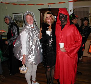 halloween costumes: hershey's kiss, flapper, red man