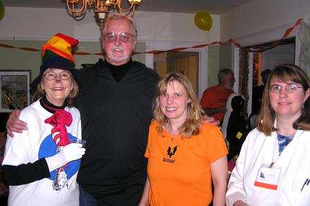 halloween party four people standing together