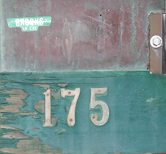 Art work. Weathered wood, red top, green-blue bottom,  175 Brooks Street, Laguna Beach