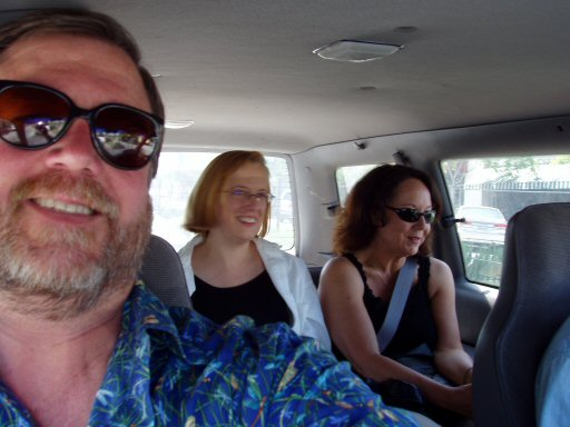 man and two women in a car