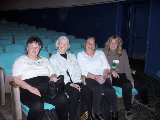 four women sitting in a theater