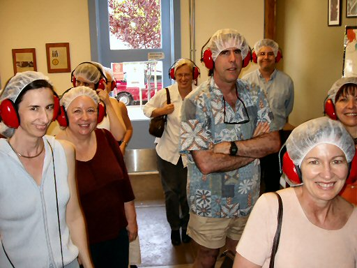 men and women wearing hairnets and red ear noise protectors