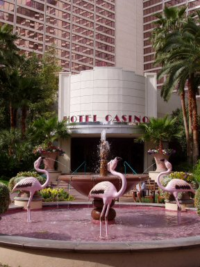 flamingo hotel entry with models of flamingos in a pool