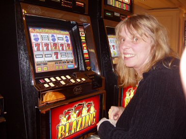woman at slot machine with all sevens