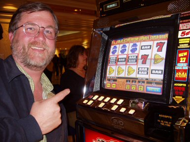 man at slot machine with three bars, three bells, and three dollar signs