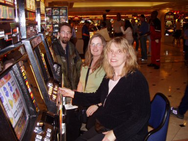 flamingo hotel slot machines with three gamblers