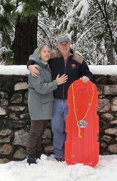 bob and carolyn with red sled