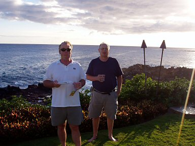 two men standing at the rock edge of kauai