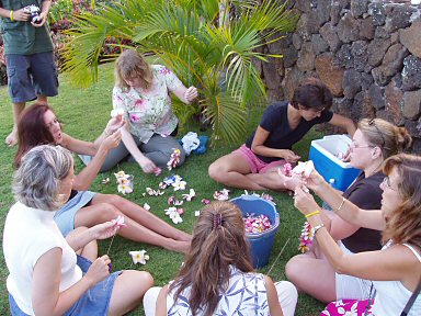 women making leis on kauai