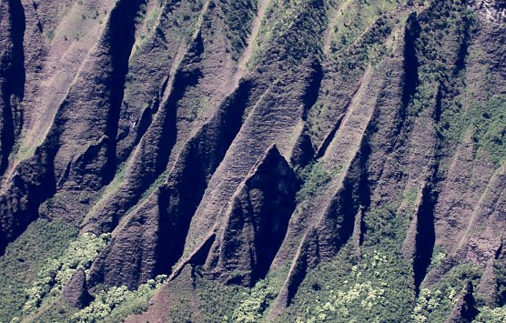 purple eroded curtains of volcanic rock, a thousand feet tall.