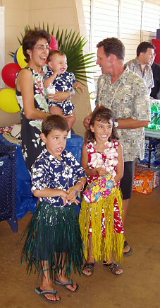 family at a luau with grass skirts