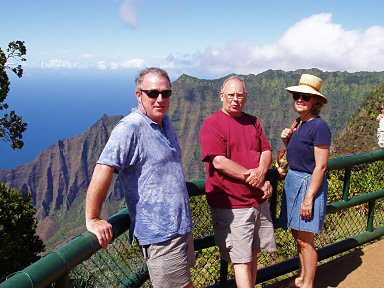 Three people at napi coast overlook.