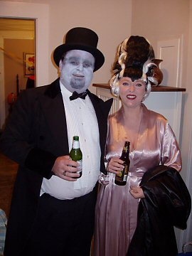 frankenstien in a top hat and his bride