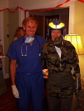 costumes: doctor in blue scrubs and woman in flight suit\