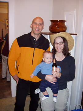bald man, farm girl, and baby