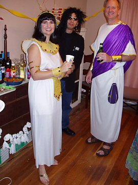 woman in cleopatra costume, man in Roman citizen garb, man dressed in black as Howard Stern