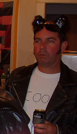 Man wearing leather jacket and cat ears