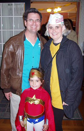 parents with daughter in Wonder Woman costume