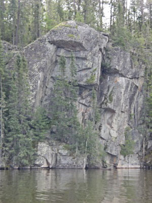 Face of an indian in the rock of the lake wall