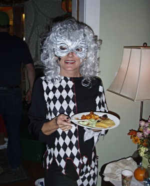 black and white harlequin costume with white wig and mask
