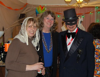 two women and a man in costume. man in top hat