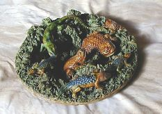 Pallisy  ware plate with frogs, lizards, and snakes. Colored dark green, blue and brown. Ugly!