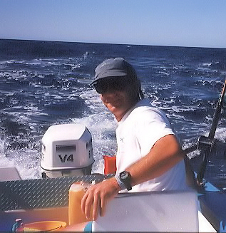 Dave Ravizza sitting in a skiff fishing for tuna