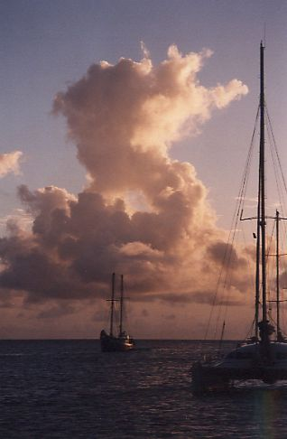 Sunset in Grenada with yacht masts against an angry sky